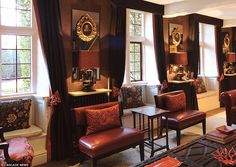 Ornate: Dark colours and heavy furnishings gave the drawing room a baroque feel but it was...