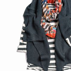 Early-fall layering tip: Ease into the season with lighter versions of your cold-weather staples, like an airy scarf and sleeveless cardigan.