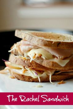 The Rachel sandwich is the Rueben's distant, sweeter cousin. This version has deli turkey, creamy Havarti cheese, homemade Russian dressing and homemade apple slaw! Rachel Sandwich Recipe, Soup And Sandwich, Sandwich Recipes, Lunch Recipes, Great Recipes, Cooking Recipes, Favorite Recipes, Sandwich Ideas, Panini Sandwiches