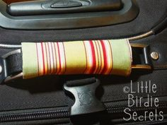Luggage handle cover from Little birdie secrets.  Less embarrassing than festooning your bag with ricrac.  Not that I would do that.