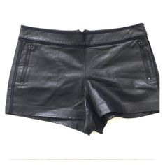 NWOT Alice + Olivia leather piped shorts org. $495 NWOT! Beautiful A&O genuine leather shorts. I purchased these with out a tag at Bloomingdales. Shorts seem to be store worn a tad bit worn slightly worn. The leather is a little stretched on the butt area. As seen in the photos. It's literally not noticeable. Either is the white stain. I never got the chance to wear them. BUT I HOPE YOU WILL! HAPPY BUYING!!!! Alice + Olivia Shorts