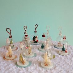 These remind me of my grandma Freda/These DIY Vintage Inspired Bell Jar ornaments are made from plastic wine glasses, but I think you could also cut down a clear plastic soda bottle to size as well, great tutorial