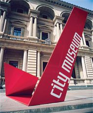 """The team designed bright red """"folded"""" monumental signs that are """"contemporary insertions"""" into the historic setting (an approach not appreciated by some more conservative members of the public, according to emerystudio). The 25mm and 40mm steel plate sign sculptures are located to subtly guide visitors upward to discover the museum entry and exhibitions."""