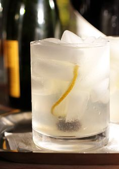 French 75...champagne, fresh lemon juice, gin, simple syrup, and ice. Wow! I must try asap.