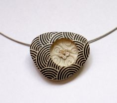 Black circles print on pearl - triangle polymer clay pendant by OrlyFuchsGalchen