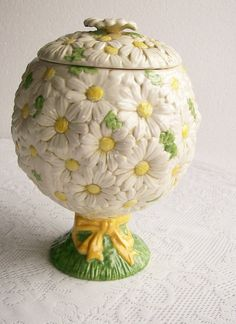 vintage cookie jar; edited to add that this pattern is  Metlox Sculptured Daisy