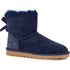 UGG Women's Mini Bailey Bow Navy Boots ($120) ❤ liked on Polyvore featuring shoes, boots, botas, ankle boots, blue, blue ankle boots, navy blue bootie, embellished ankle boots, ugg australia boots and mini boots