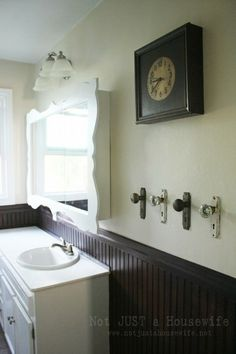 DIY project du jour:   Turn old door knobs into useful hooks.  (photo:Not Just a Housewife blog)