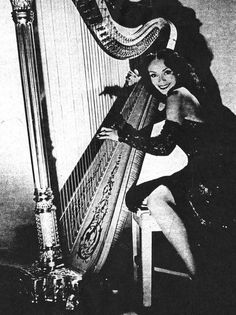 """Olivette Miller (1914-2003) celebrated """"swing"""" harpist, circa 1940s. Ms. Miller's father was Flournoy Miller, who co-wrote and produced the groundbreaking Broadway musical """"Shuffle Along."""" Raised on Harlem's Striver's Row, she studied music in Paris and at Juilliard. Ms. Miller's stunning beauty and colorful love-life kept her in the newspapers almost as much as her performances around the country and the world. Ms. Miller died on April 27, 2003 at the age of 89. Photo: Schomburg Center."""