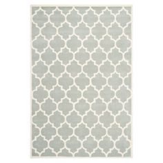 Anchor your living room seating group or define space in the den with this hand-tufted wool rug, featuring an eye-catching quatrefoil trellis motif....