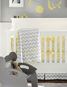 yellow + gray | modern nursery | pottery barn kids- great use of patterns and colors. For a more elegant look they added wood paneling to the bottom quarter of the wall.