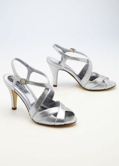 ae685244cf890 Sandals feature eye catching cross strap detail and sparkling rhinestone  clasp. Heel measures 3 Fully lined.