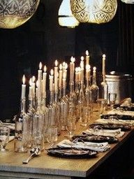 Sparkly wine bottle candle holders make this such a pretty table!