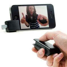 iPhone Shutter Remote.   $28.00 and you don't have to take bathroom pictures ever again!