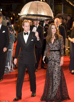 Seen it before: The Duchess previously wore the gown to the film premiere of War Horse when Prince William held an umbrella to shelter her f...