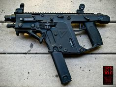 Kriss Vector SDP pistol - with vertical grip (a modified AFG design) and Surefire Executive Series light - See more at: http://www.thefirearmblog.com/blog/2014/10/08/kriss-vector-battery-detonation/#sthash.rO8S1X7P.dpuf