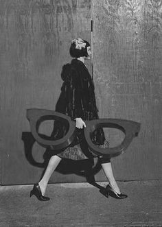 love this flapper carrying huge glasses.
