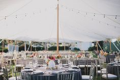 Tented outdoor wedding with gray linens and bistro lighting | Muckenthaler Mansion Fullerton, CA