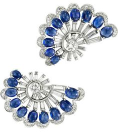 Meister Sapphire Diamond Ear Clips.  Meister, A Pair of Sapphire and Diamond Ear Clips, each designed as a stylized circular-cut diamond fan, trimmed with cabochon sapphires, mounted in platinum, with maker's mark for Meister, circa 1940.