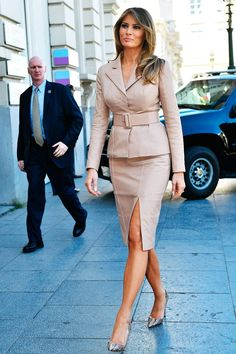 Melania in Brussels, wearing Belgian designer Maison Ullens and a pair of Manolo Blahnik snakeskin heels By Eric Lalmand/AFP/Getty Images.