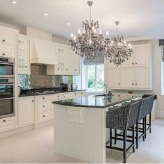 My favorite things about this kitchen are the chandeliers and the counter height stools.