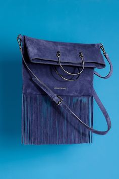 The it-bag that's topping our list: swingy fringe in rich suede.