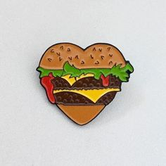 "#Repost @wwwhiteyyy I burgers 1.25"" soft ename pin w. black rubber catch // individually carded // limited to 50 // wwwhiteyyy.bigcartel.com // #burgerheart (Posted by https://bbllowwnn.com/) Tap the photo for purchase info. Follow @bbllowwnn on Instagram for great pins patches and more!"