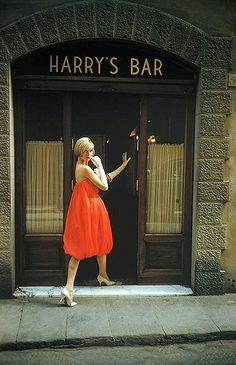 "Model in Fabiani's ""bag"" dress is entering Harry's Bar in Paris, photo by Mark Shaw, 1957"