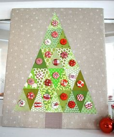 Triangle tree. Would be cute to attach a button decoration for each day closer to christmas. When the tree Is full its christmas!
