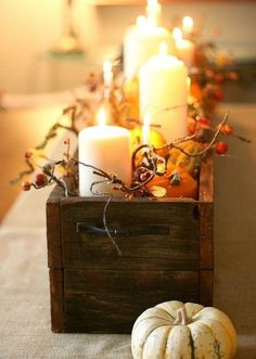 Wooden box ivory candles centrepiece for the dining room table.