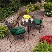 "Outdoor Wrought Iron Bistro Set W / Free Green Cushions by Wrought Iron. $299.00. Enjoy sunny weather in the comfort of this BEAUTIFUL 3pc Wrought Iron Bistro Set. The beautiful, traditional design is great for casual outdoor setting. The cushions are covered in a high-quality UV-rated fabric to resist fading.   3pc Wrought Iron Bistro Set: Includes 2 chairs and 1 mesh top bistro table Chair dimensions: 24.25""L x 22.75""W x 34.25""H Table dimensions: 24""L x 24""W x ..."