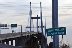 "Online Athens article on previous attempts to change name of Eugene Talmadge Bridge in Savannah, Georgia.  ""A sign marks the Talmadge Bridge as traffic merges in from South Carolina and Hutchinson Island. (Richard Burkhart/Savannah Morning News)"""