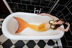 Photograph of real life mermaid Melusine of Merlesque relaxing in the bath at the beautiful Anstey Hall, Cambridge. Check out her beautiful underwater costume, complete with a real scallop shell bra - just like the Little Mermaid! Find out more about Merlesque at http://www.realmermaids.co.uk  Photoshoot in conjunction with the Neon Moon Burlesque and Cabaret Club.    Photograph by Andrew Stawarz.