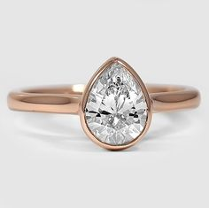This Brilliant Earth ring features a bezel set center diamond with a sleek and delicate band for a modern and contemporary look.