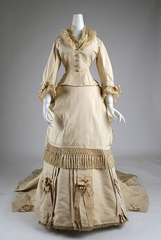 Front view, Wedding dress by Mme. Frederique, c. 1872, American, silk. Metropolitan Museum of Art.