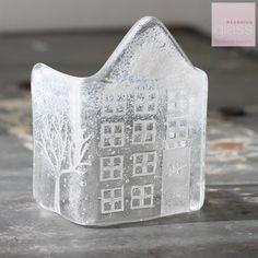 Glass snowy house