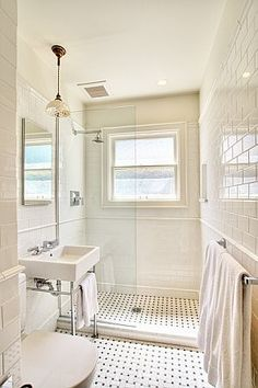 Bath remodel...wall to wall subway + basketweave + white. Love how the use of a half piece of frameless glass allows for an unobstructed view. So bright and beautiful.