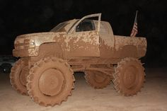 Mudding, a lifted truck, and an American flag! Must be a Texas thing!