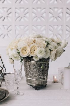 Moroccan buckets spilling with blooms / The LANE Monochrome Moroccan shoot (instagram: the_lane)