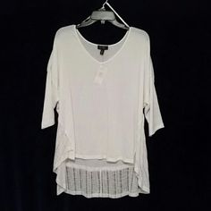 Jessica Simpson top It falls about six inches longer in the back. This will be a popular go to item in your wardrobe it is so cute! Jessica Simpson Tops