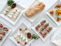 White platters on white linen/ appetizer table at White Party