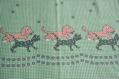 This would make an adorable vintage look apron.  Vintage Border Fabric Cats and Dogs on Green by pumpkintruck.