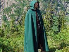 he wore a green hooded coat