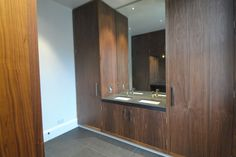 Walnut vanity unit between walnut wardrobes