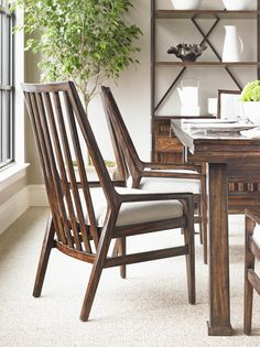 The neutral, nubby Fawn fabric on the seat of the Wood Back Chair lends the design both dimension and flexibility. | Stanley Furniture