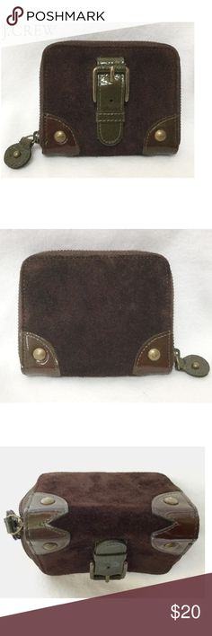 NEW J Crew Coin Credit Card Purse/Wallet NWOT J Crew Coin Purse Credit Card Wallet  Brown Suede with Patent Leather  Buckle and Stud Detailing  Divided interior with zip around closure Slots for ID/Credit Cards - Space for Coins/Bills New- Never used - has been sitting stored my purse closet!  20% OFF BUNDLES Please use offer button to submit offer   view OFFER CHART for reference  REDUCED/LOWERED/FINAL items at lowest~bundle only for add'l disc LOWBALL offers will not be considered Thanks…