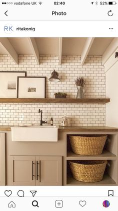 Nice colour scheme for the cabinetry and goes well with the tile work.