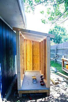 This small wooden shed is big enough to store a lawn mower and some gardening supplies. We'll show you how to build one just like it in your backyard. garden shed diy How to Build a Small Wooden Shed