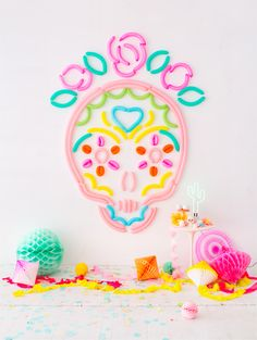 Cute, colorful DIY sugar skull balloon backdrop.
