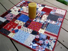 Patriotic Hodge Podge 26 inch quilted table topper in red, white and blue